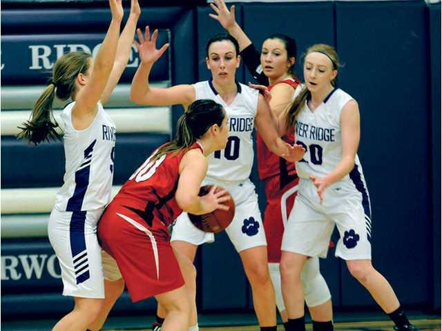 Lady Timberwolves put the clamps on Highland