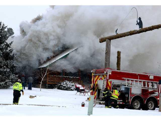 High winds fuel house fire