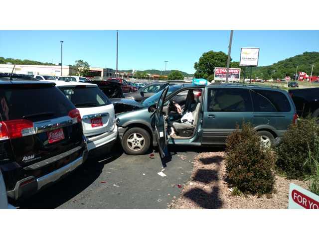 Dealership vehicles damaged in crash