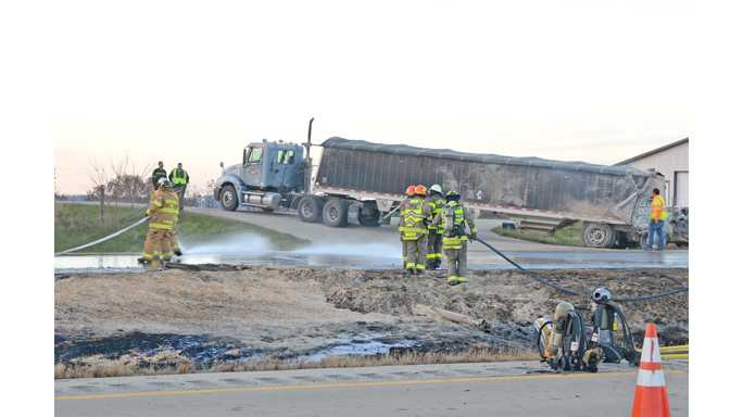 Trucks towing sawdust, corn collide