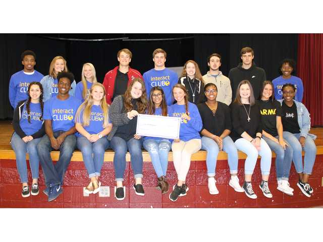 Interact Club members are (front row, from left) Sam Galan, Matthew Brown, Jessica Cooper, Ellie Gordon, Priyal Patel, Madelyn Smith, Kamryn Taylor, Julianna Hall, Halie Rose, Jaelyn Parker, (back row, from left) Darius Scott, Lauren Conaway, Lexi Murray, Nolan Meeks, Trevor driggers, Caitlyn Kowalker, Devin Gilchrist, Blake Lee and Zakiyya Jackson. Members Zoe Kreyenbuhl, Madison Messer and Carson Burns are not pictured. The pictured group is holding a replica check for Casa de Mariposas.
